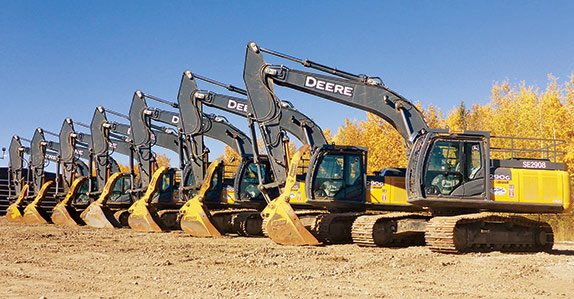 A line-up of John Deere hydraulic excavators ready for auction.